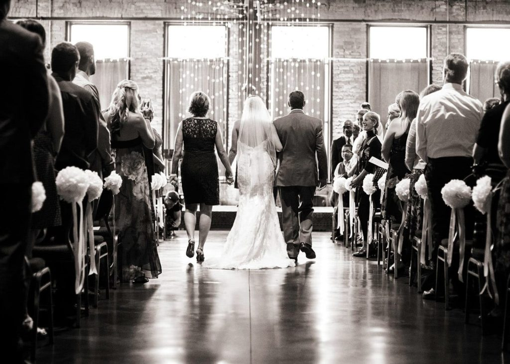 Bride walking down the aisle at Clyde Iron Works